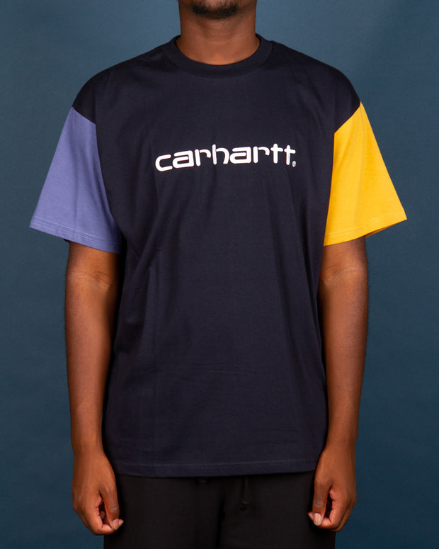 The Carhartt Tricol T-Shirt in Dark navy is made from a pure soft cotton jersey. This short sleeve t-shirt has a solid block tri-colour design and features an embroidered script Carhartt logo across the chest. Finished with a comfortable ribbed neckline and a relaxed fit.