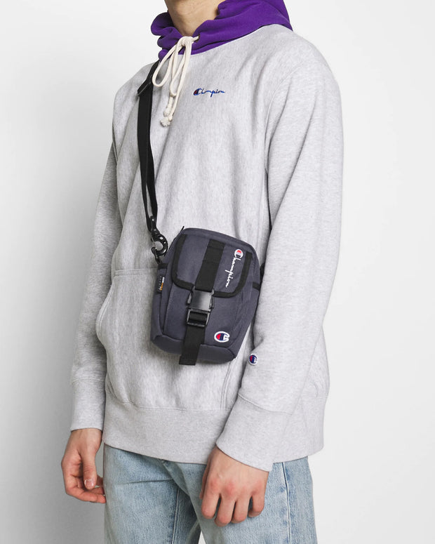 Champion helps you keep your essentials on hand with the Cordura Small Side Bag in Blue Grey. Constructed from Cordura and featuring an adjustable strap, front clip closure and zip pockets, this bag is perfect for summer days or just everyday travel.