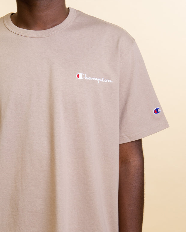 A simple option for your t-shirt rotation. The Champion Heritage Embroidered Script Tee in Dark Khaki is constructed from pure cotton and features a comfortable ribbed neckline with a Champion script embroidered on the chest. This tee is perfect for the warmer days, built to be lightweight and an easy layering option.