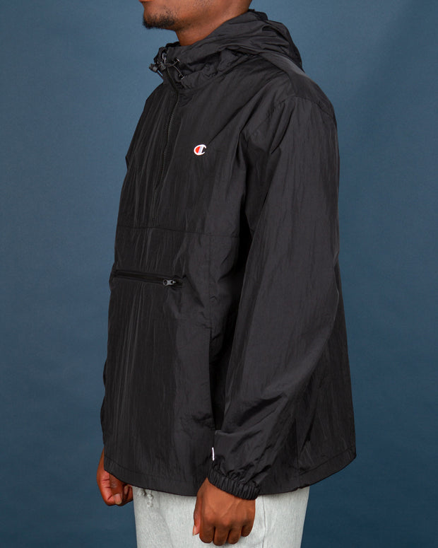 Pack it up and take it anywhere, this Champion jacket is water-resistant and can be folded up and packed into the front pocket, perfect for taking away on adventures. The Champion LF Packable Anorak features a half-zip pullover hood and zipper, bungee lock hood and waistband along with elasticated trims. This black jacket is signed off with the Champion C logo embroidered on the chest and sleeve.