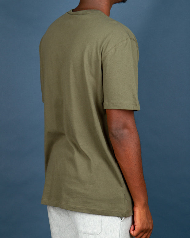 A staple in your streetwear wardrobe, the Champion RB Light Tee in Tourmaline Green does good for the planet with Re:bound reclaiming excess fabric discarded during production and reusing. This short sleeve t-shirt is olive green in colour and is cut from soft cotton, 45% recycled, fit with a ribbed neckline in a relaxed fit. Signed off with the Champion C logo embroidered to the chest and left sleeve.