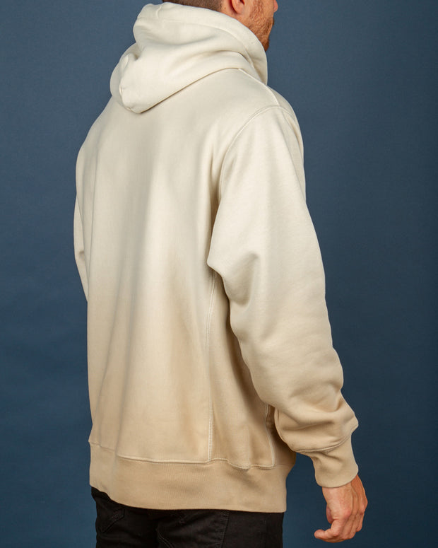 The latest release from Champion is available at Fallen Front and features the Champion Reverse Weave Ombre Hoodie in nude. Built from the famous Reverse Weave Technology, this beige pullover hoodie has a premium feel and durable construction. With a garment dip-dye process for an ombre style, this hoodie is signed off with a Champion logo embroidered at the centre chest and the iconic 'C' logo on the sleeve.