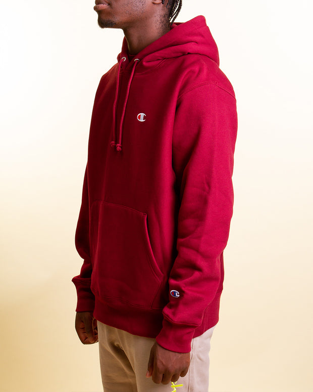 Champion Reverse Weave Hoodie in a sepia red colourway, featuring the champion c logo on the sleeve and chest.