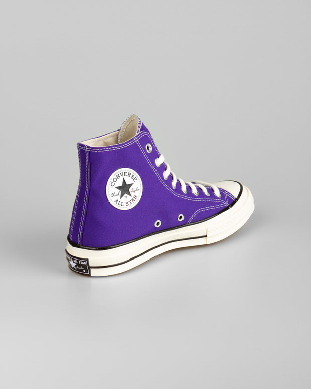 The latest edition to the '70s family. The Converse Chuck Taylor All Star 1970's Hi in Candy Grape. Filled with a vibrant hue of purple in the upper, this pair of chuck 70s will add spark to any weekend outfit. Constructed from canvas uppers and featuring the iconic high foxing tape and rubber outsoles, these fruity sneakers are bound to be your next head turner.