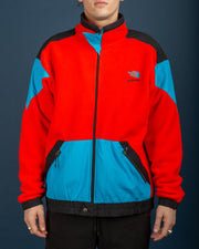 The North Face Jacket in red and blue with some black panels. The North Face logo on the front chest