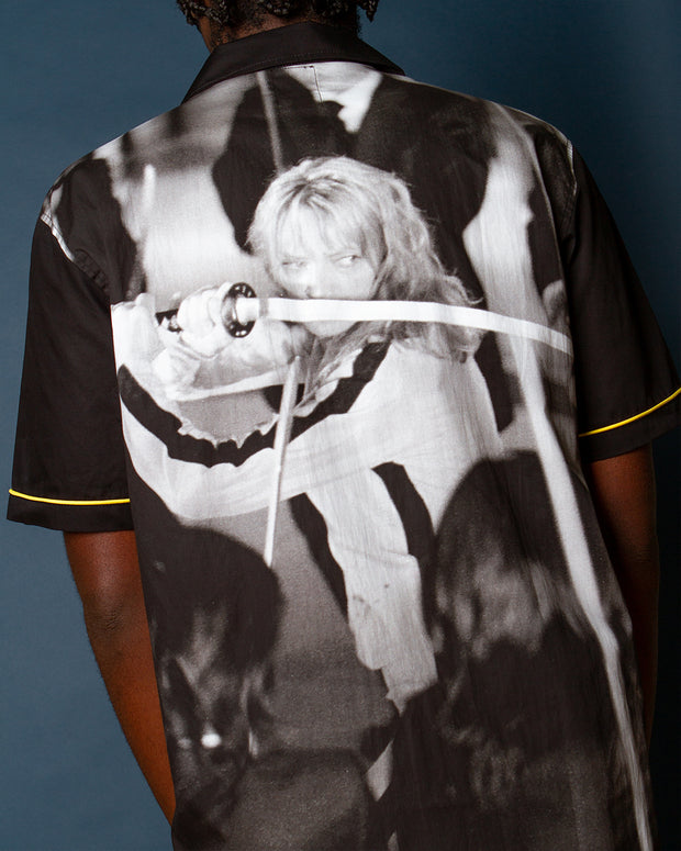 Inspired by vintage bowling shirts, the Crazy 88 Woven Shirt from the latest HUF x Kill Bill collaboration is constructed from sturdy cotton poplin. Featuring contrasting yellow piping details and signed off with a printed Kill Bill film still at the back which cuts a still from the iconic Showdown at the House of Blue Leaves scene.