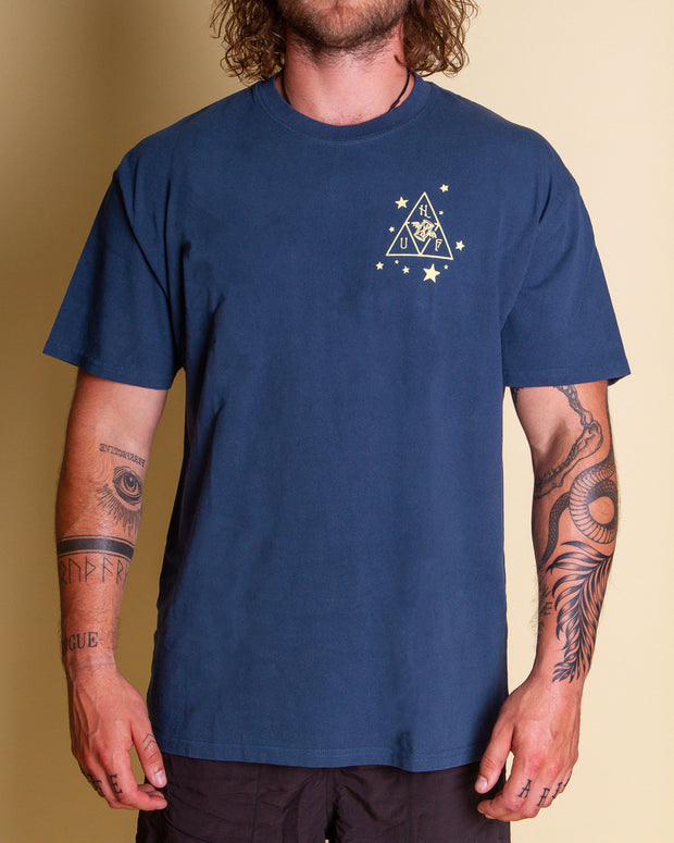 The HUF x Smashing Pumpkins Starlight Tee in Navy celebrates the 25th anniversary of The Smashing Pumpkins famous album. Mellon Collie and the Infinite Sadness. Constructed from premium cotton, this short-sleeve features the iconic 'Star Girl' inside a HUF Triple Triangle logo on the back, with a Mellon Collie-inspired graphic screen-printed at the left chest. Finished with a custom enzyme wash for vintage and worn-in feel, making this t-shirt the next generation of band merch.