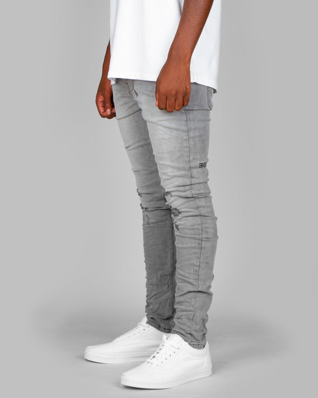 The Ksubi Chitch jeans take a new route with the Prodigy Trashed. Constructed from a premium denim blend, these heavy-duty jeans are perfect for everyday wear, comfortable and stylish. This vintage grey colourway features trashed knees for a rock and roll vibe, followed up with a 5 pocket set up, button fly and an embroidered logo for detailing.