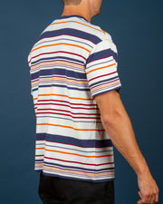 The MISFIT Blue Uprising Tee in Navy is a short-sleeve waffle knit t-shirt, constructed from pure cotton, yarn-dyed stripe knit. Made with a short and boxy fit, this tee is comfortable and set with a rib-knit neck band and premium trims. Perfect to throw on and go with contrasting, navy, red, orange and cream stripes.