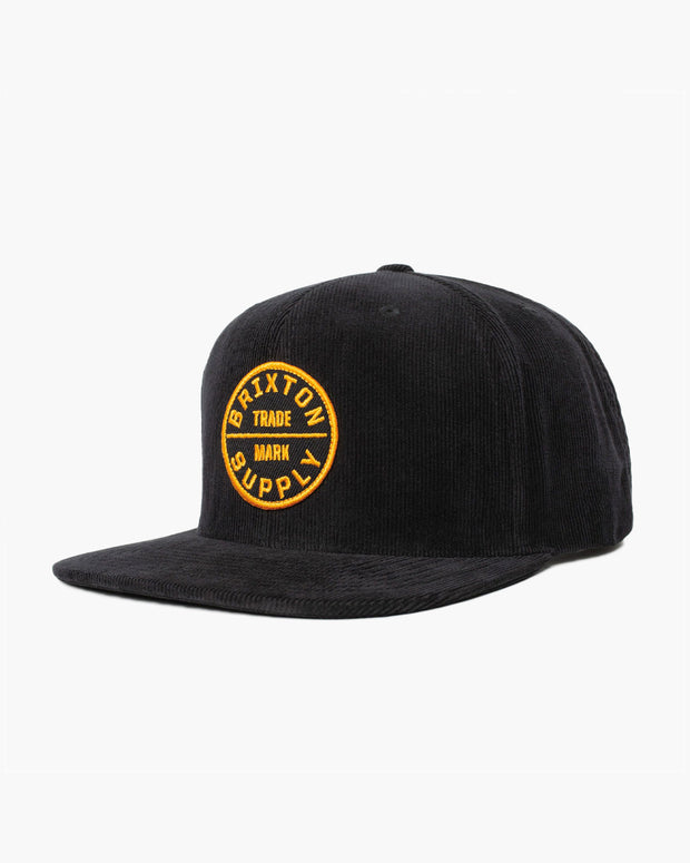 The Oath III Snapback hat in Black from Brixton, made with a courdory material and yellow custom brixton badge.