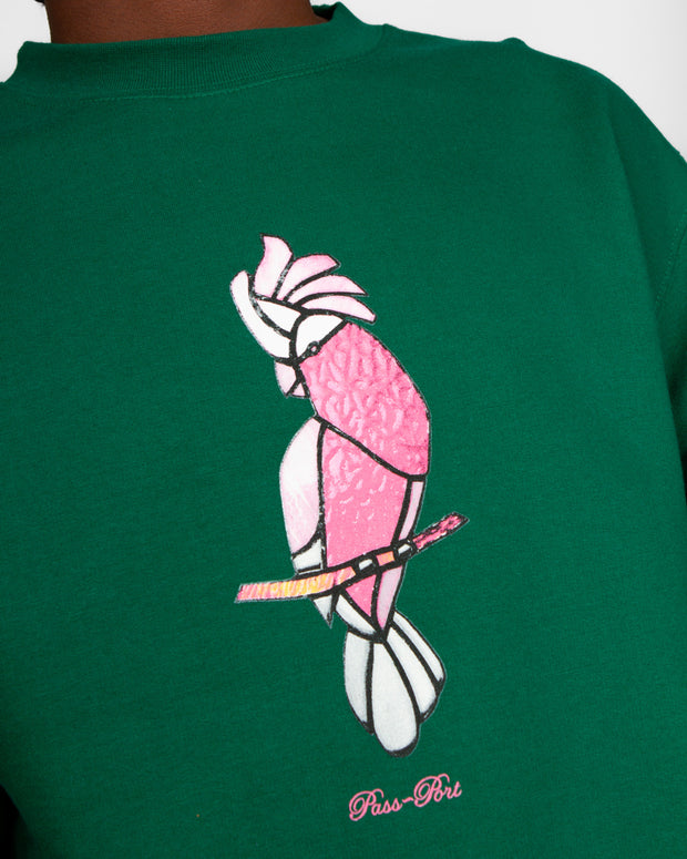 Pass~Port clothing has its roots in skate culture, their approach has since become popular in the streetwear scene, especially for the high quality and simple styling. The Glass Galah Sweater in Dark Green is cut from pure cotton and printed with a bird graphic on the front. This crewneck comes in a regular fit and features premium ribbed trims to sign off.