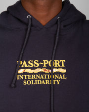 The Pass~Port Clothing Intersolid Hoodie in navy is street-savvy and super comfortable. Constructed from a premium cotton blend, this pullover features an adjustable drawstring hood, front kangaroo pocket and ribbed trims. Signed off with the iconic PassPort International Solidarity graphic printed on the centre front.