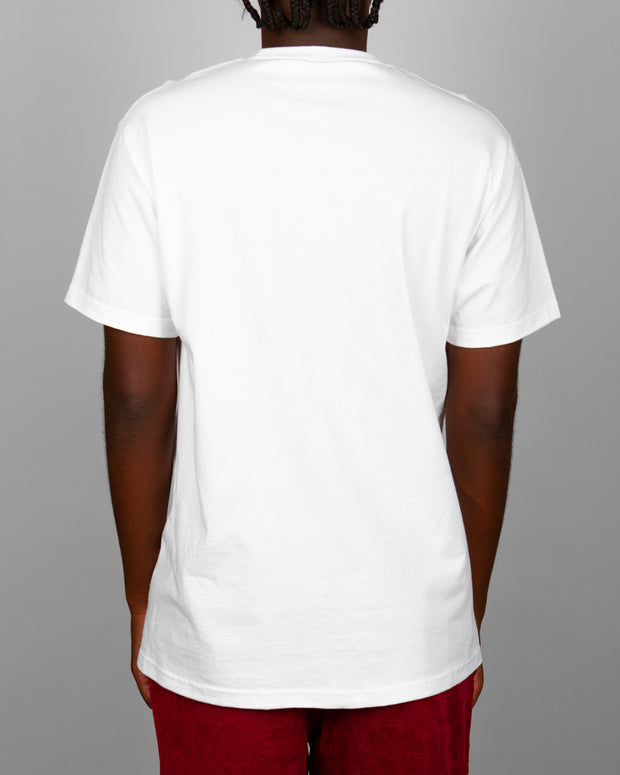 The Pass~Port Clothing L.I Brick Tee in White features a graphic print on the front of a premium pure cotton staple white t-shirt. Easy to pair with anything in your wardrobe, this short-sleeve tee comes in a regular fit and is finished with ribbed trims.