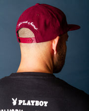 The Pass Port Skateboards With a Friend 5 Panel Cap in Burgundy is made from durable cotton corduroy with a comfortable 6-panel shape. This headwear style comes in a burgundy, wine colourway and is signed with a decorative front patch with white embroidery on the back. Coming with a straight peak, this cap is perfect to throw on for any adventure.