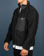 One of our favourite pieces from the new Patagonia range. The Patagonia Classic Retro-X Jacket in Black is an everyday piece, perfect for layering for city walks or deep jungle adventure. This Retro-X jacket is made from cosy fleece and features mesh lining which traps heat in. Signed with a chest pocket for smaller essentials along with the Patagonia P-6 Logo woven on to the front.