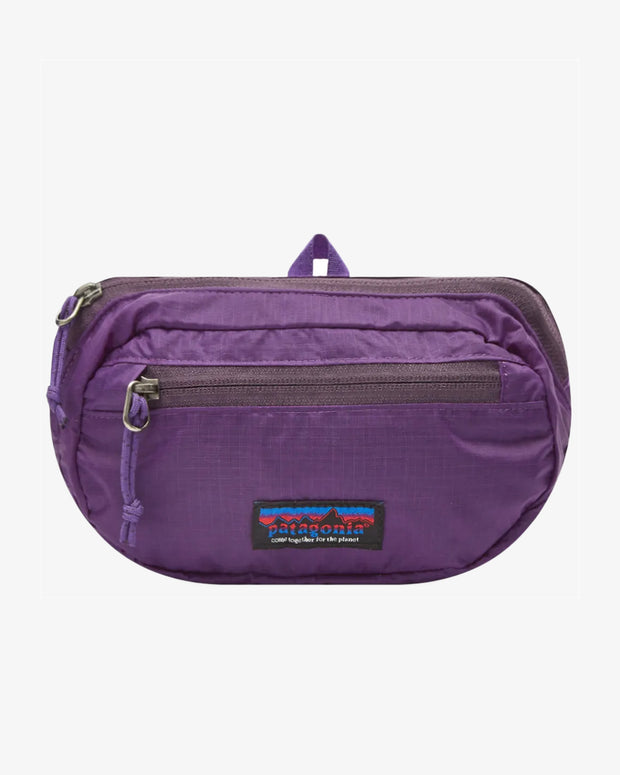 the Patagonia Ultralight Black Hole Mini Hip Pack in Purple is ready to keep all your smaller essentials close by and hands-free.
