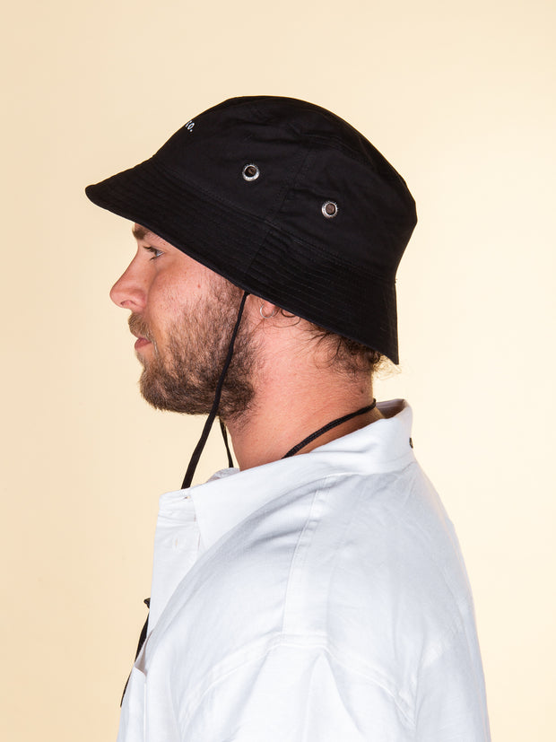 Side profile of black RPM bucket hat, short brim, silver eyelets