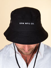 Black bucket hat with black draw cord, small white RPM MFG Cp font logo. Stainless eyelets.