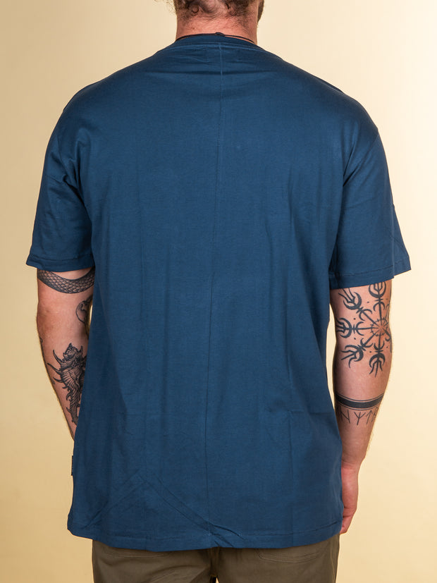 Back view of the RPM stitch tee in Cobalt. The back of the tee is black, no prints or detailing. This is a standard sized tee from RPM.
