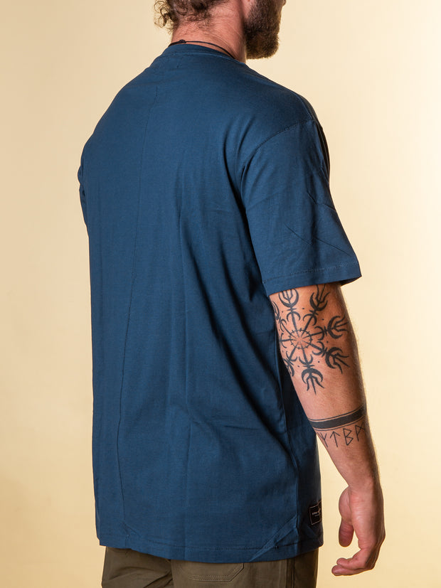 Back right view of the the stitch tee by RPM MFG. Glimpse of the side label at bottom right.