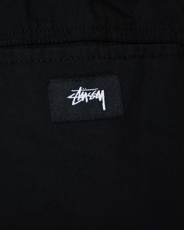 One this Stussy does better than anyone is bringing summer and beach vibes. The Basic Stock Beach short is everything you need for a breezy day in or out of the water. Constructed from a cotton fabrication, these shorts are lightweight, comfortable and feature an elasticated waistband. Signed off with two pockets and an embroidered logo patch, along with a woven label on the back pocket, these black shorts are perfect for everyday wear.