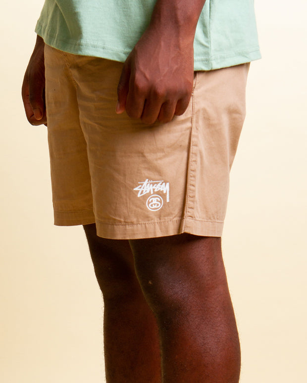 Stussy returns to Fallen Front with a fresh pair of beach shorts. The Stussy Basic Stock Beach short in Tannin is comfortable and ready to roll. Constructed from pure cotton and featuring an elasticated waistband, these tan coloured swim shorts are signed off with a front stussy logo graphic and a woven label at the back pocket.