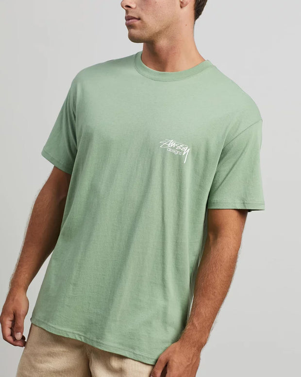 The Stussy Designs Tee in Solid Basil is constructed from 100% cotton and comes in a soft basil colour. Complete with a simple and effective design, this t-shirt is signed off with a Stussy Designs logo to the left chest and premium trims for added comfort.