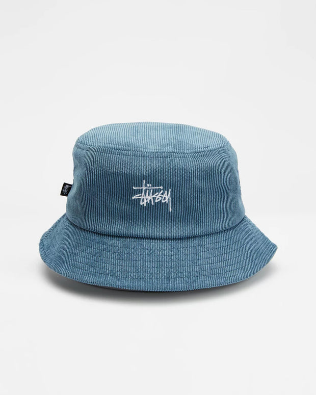 A simple staple to add flair to any outfit. The Stussy Graffiti Cord Bucket Hat in Blue is constructed from soft corduroy fabric and features an embroidered logo at the crown. This unstructured bucket hat is complete with a short brim in a dusty blue colour.