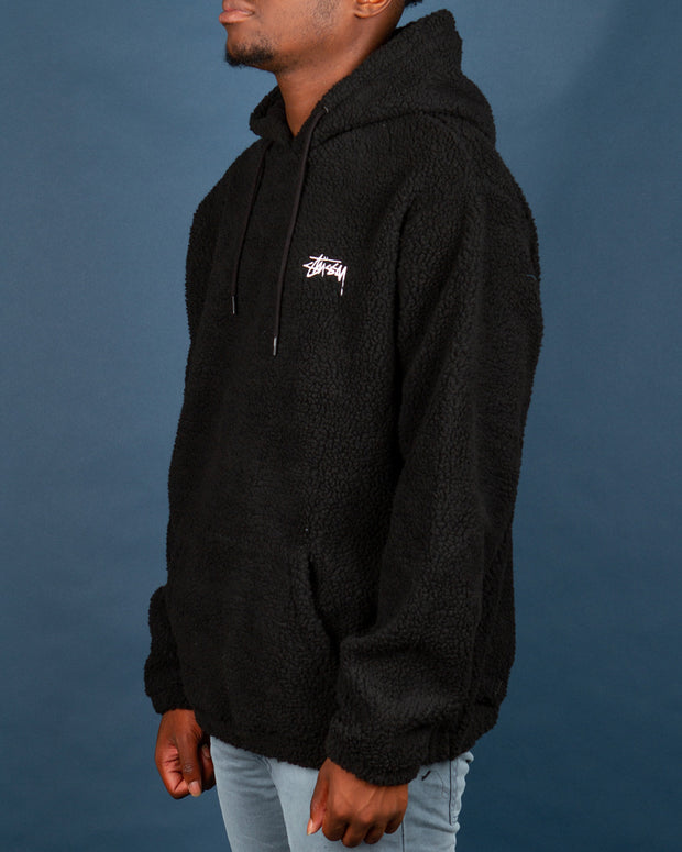 A first here at FallenFront, the Stussy Stock Sherpa Hood in Black hits different to the rest. Perfect for lounging or heading to the city and looking for an oversized fit, this sherpa hoodie is the one for you. Constructed from sherpa fleece and featuring white Stussy embroidered detail on the left chest. Signed off with elasticated cuffs and hem as well as a front kangaroo pocket and comfortable drawstring hood.