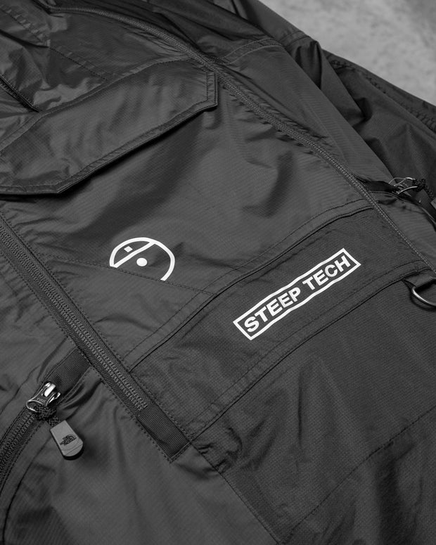Dropping from their latest Steep Tech line, The North Face U Steep Light Rain Jacket is born. Geared toward a retro skier style with a modern city focus, this jacket comes prepped in a TNF Black colourway. Constructed and built for function and utility, this jacket is cut from breathable, wind-resistant and waterproof nylon, whilst detailed with a large array of pockets for your essentials. Signed off with printed The North Face branding across the jacket.
