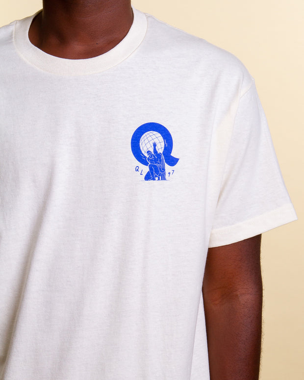 The Quiet Life takes inspiration from the heavy lifting duties of Atlas with the Atlas Short-Sleeved T-Shirt in cream. Constructed from pure cotton, this comfortable cream coloured tee features a popping blue graphic printed on the front and back, finished with The Quiet Life branding as a signature.
