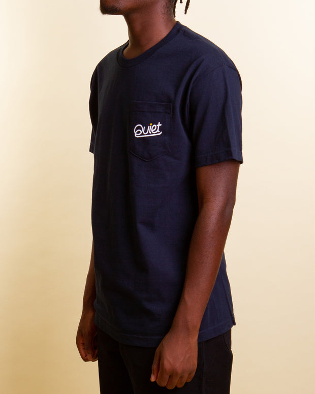 A simple basic for your everyday wardrobe, The Quiet Life Quiet Script Pocket tee is a navy short-sleeved t-shirt that features a front chest pocket that hints a branded 'Quiet' screenprint in white. Signed off with a ribbed neckline and premium trims, this t-shirt is comfortable and easy to wear.