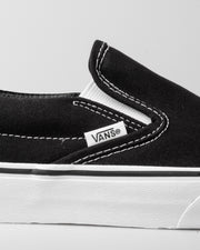 The Vans Classic Slip-On in Black and White is an easy to wear skate shoe that goes with literally anything in your streetwear wardrobe. Constructed with sturdy canvas uppers, a comfortably cushioned footbed, a crisp white rubber midsole and the iconic gum rubber waffle outsole. Ready for the streets, the skatepark, the movies or your living room, these Vans shoes will have you looking slick.