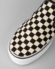 The classic skate shoe from Vans. The Vans Slip-On Checkerboard has been pivotal for the OG brand. Perfect for hitting the city, skate park or just chilling in the house, this slip-on shoe will have you ready no matter what the occasion. Constructed from premium canvas uppers with a cushioned footbed and vulcanized rubber midsole, these low profile shoes feature a checkerboard pattern on the canvas and are finished with the iconic gum rubber waffle outsole.