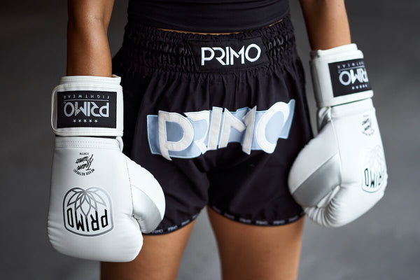 boxing gloves and muay thai shorts