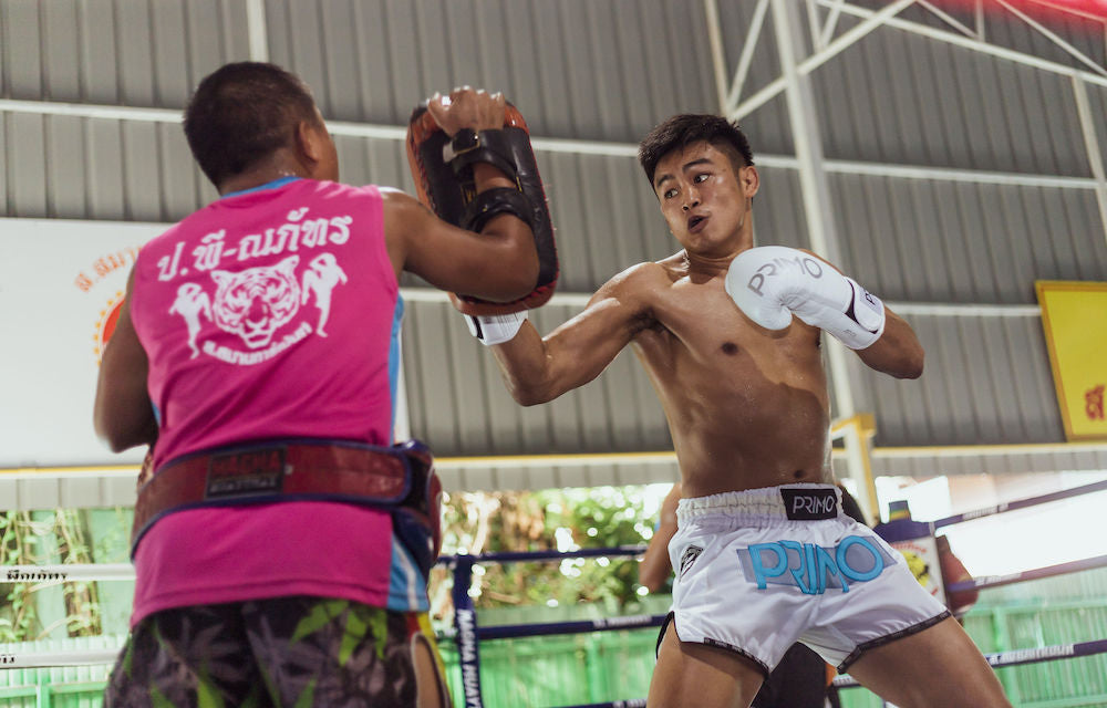 muay thai fighter sangmanee hitting pads