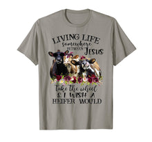 Load image into Gallery viewer, Living life somewhere between Jesus take the wheel cow shirt