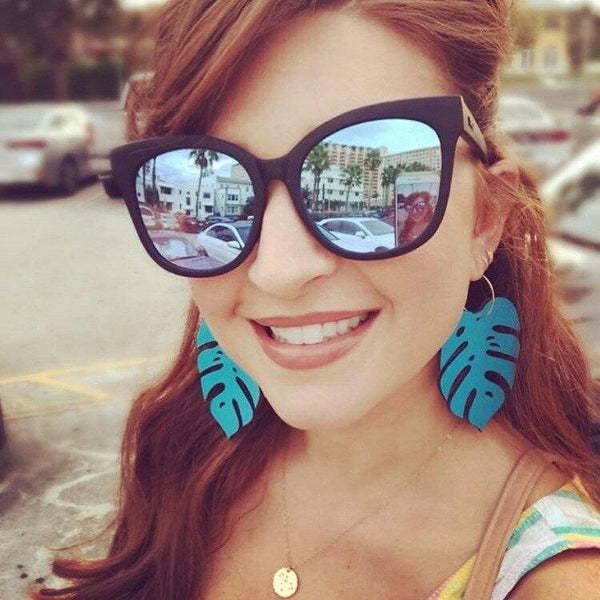 Girl Wearing Giant Turquoise Monstera Hoops