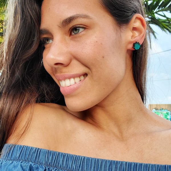 Girl Smiling looking away, wearing Agave Earrings