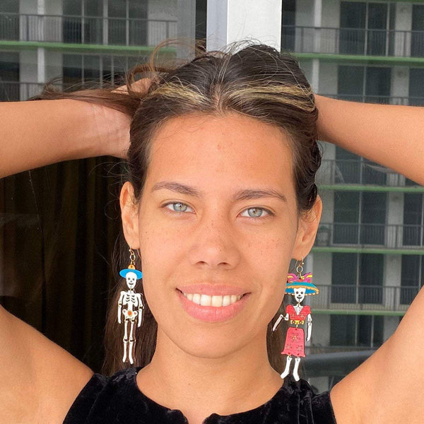 Girl wearing Catrina Dangle Earrings