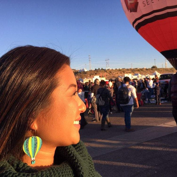 Girl Wearing Hot Air Balloon Earrings, Balloo Fiesta Earring