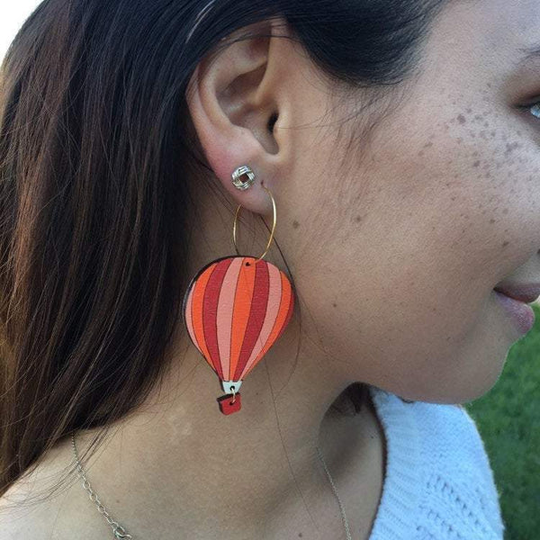 Girl Wearing Hot Air Balloon Earrings