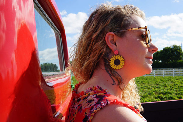 Girl wearing Sunflower Dangle Earrings