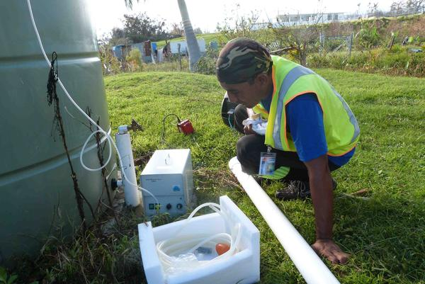 Relief workers using A2Z Ozone Mp 8000 to purify the islands drinking water