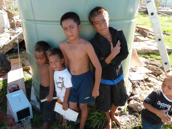 Thirsty kids waiting for clean water.