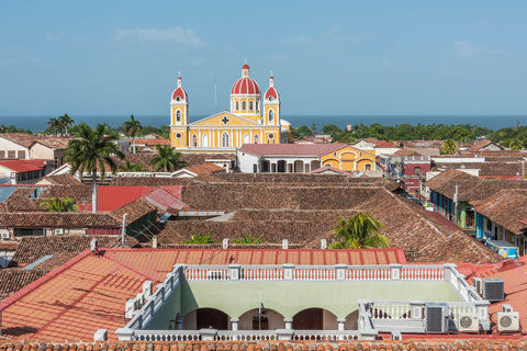 Granada Nicaragua Cathedral looms over the colorful coastal town in Central America.