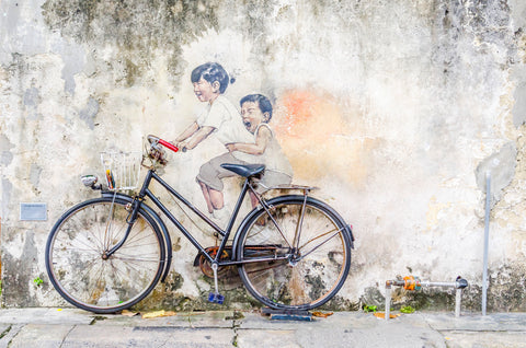 Penang Malaysia Street Art, Little children on a bicycle.