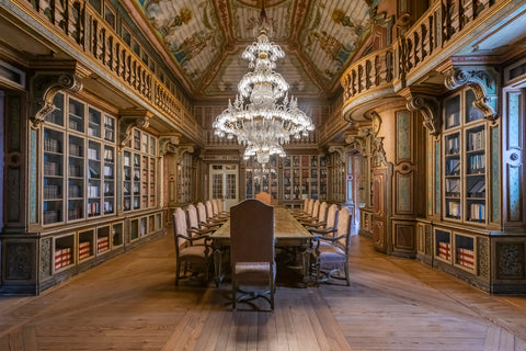 The Red Cross library in Lisbon, Portugal is a beautiful wooden ornate room.