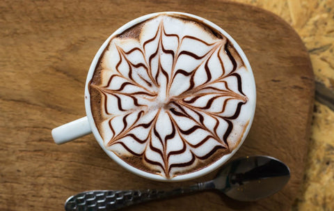 etched spiral coffee art using chocolate syrup