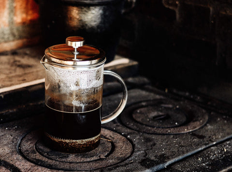coffee being brewed in a french press
